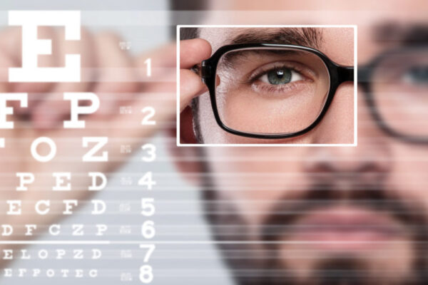 Male face and eye chart. Eyesight concept